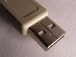 Comment faire pour installer les paramètres réseau sans fil utilisant une clé USB